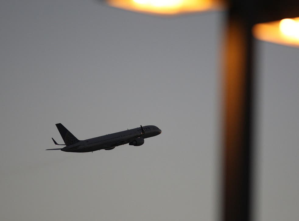 A United Airlines jet takes off at LAX