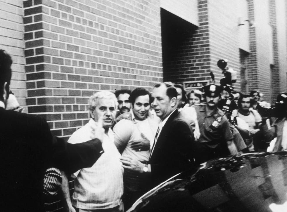Serial killer David Berkowitz surrounded by police and reporters