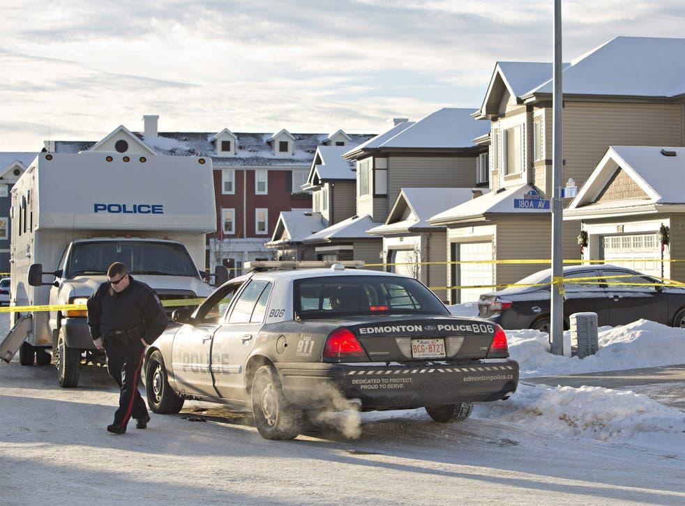 Police investigate the scene where multiple deaths occurred in Edmonton, Alberta, Canada