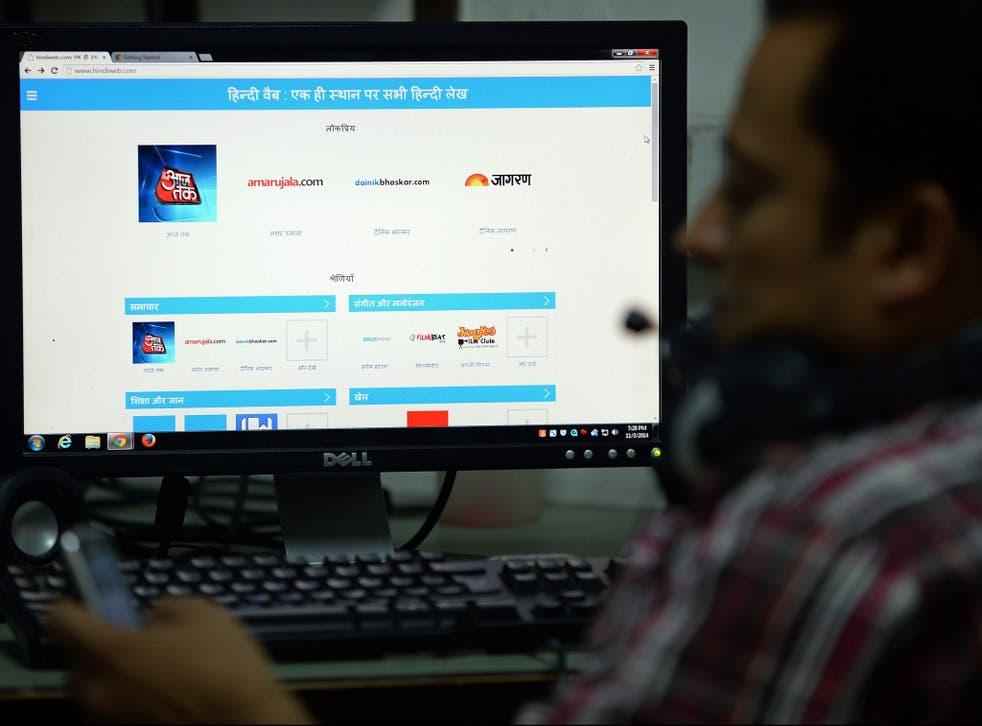 An Indian man browses the google-run hindiweb.com website in New Delhi on November 3, 2014