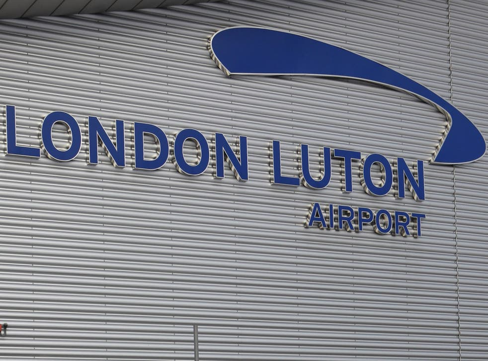 A woman has been arrested at Luton airport