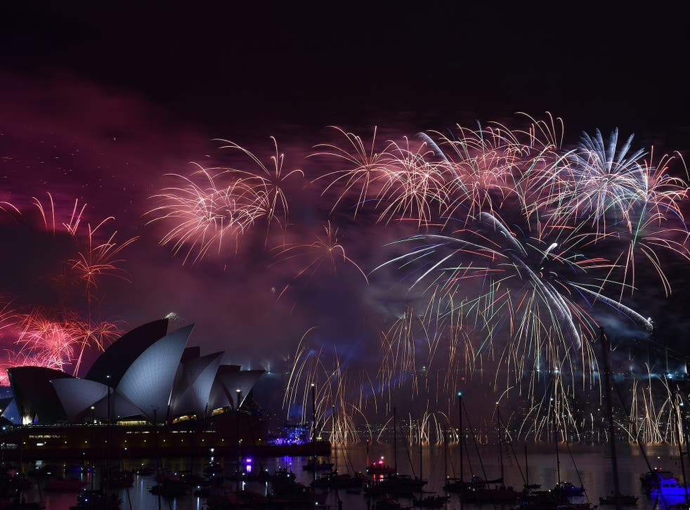 New Year's fireworks erupt over Sydney's iconic Harbour Bridge and Opera House during the traditional fireworks at midnight on January 1, 2015.