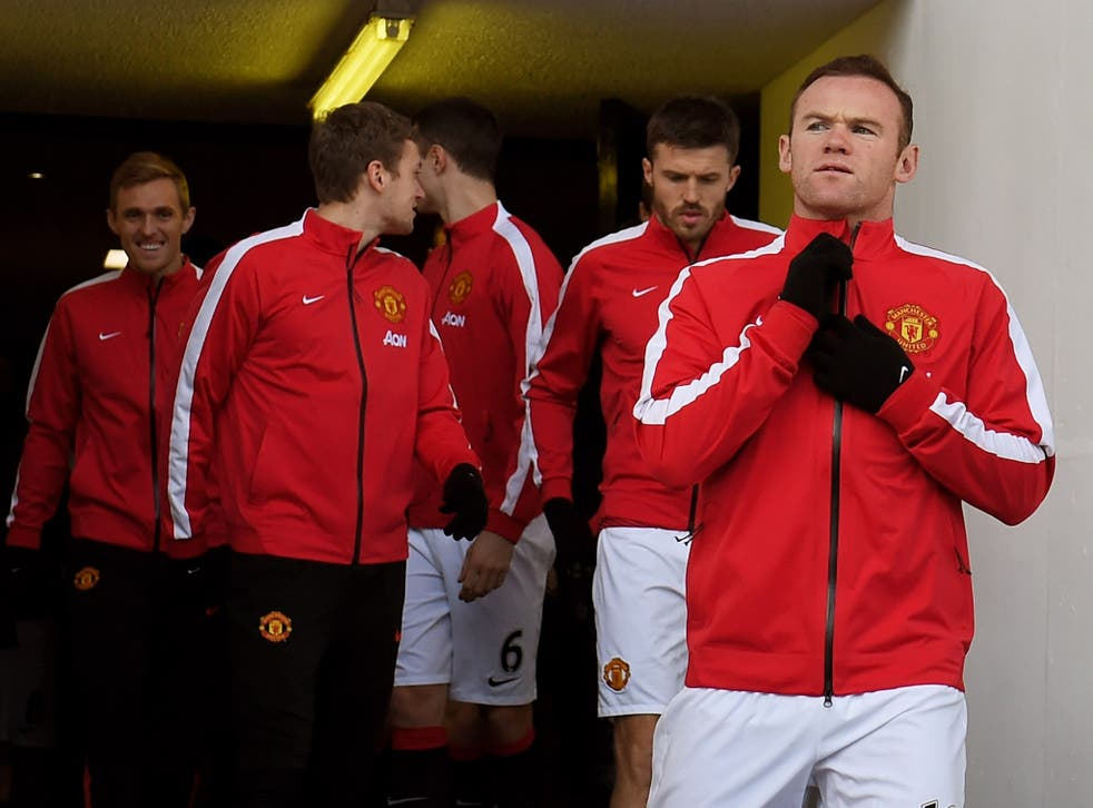 Wayne Rooney with his Manchester United team-mates