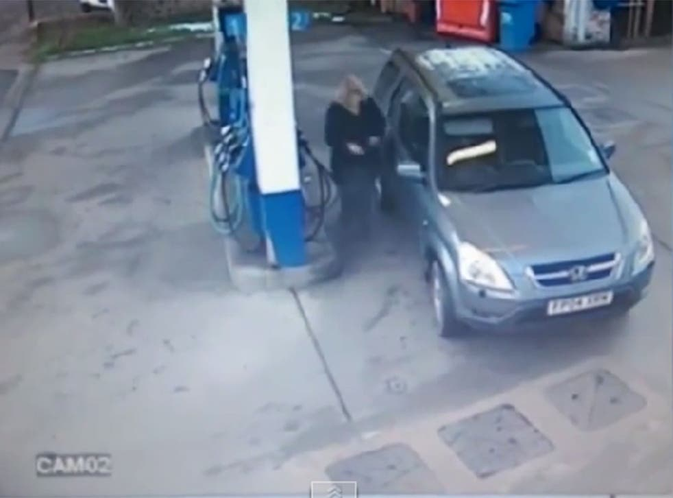 Driver goes round in circles in epic fail at petrol station.