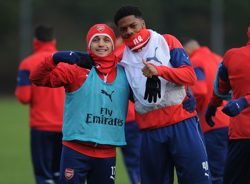 Alexis Sanchez (left) and Chuba Akpom in training with Arsenal today