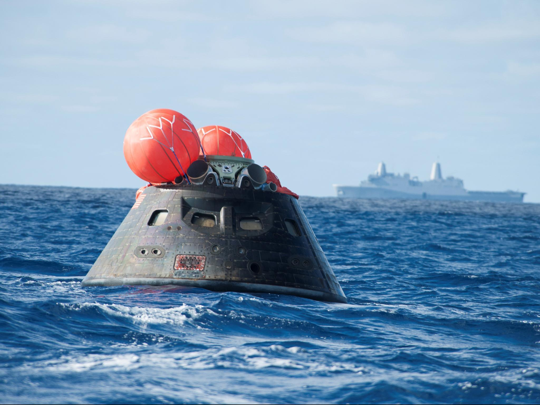 Orion Capsule splashes down