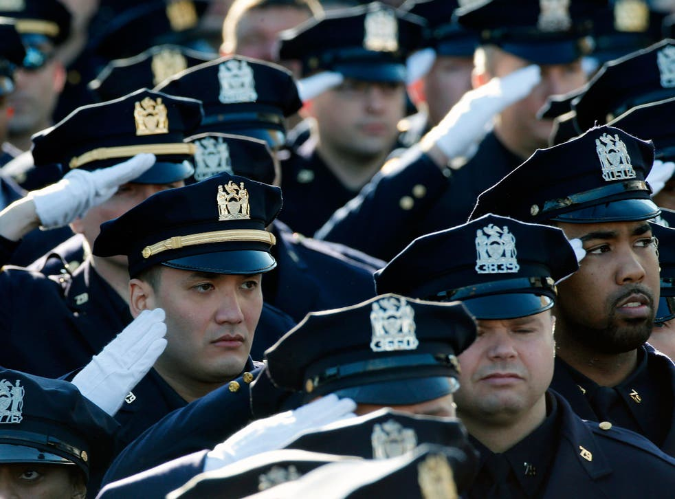NYPD police salute during national anthem