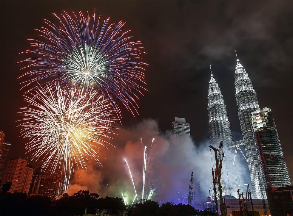 Fireworks explode near Kuala Lumpur's landmark Petronas Towers
