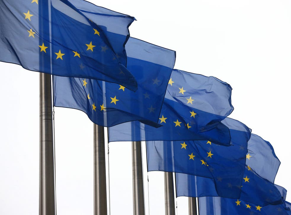European Union flags fly outside the European Commission building in Brussels, Belgium.