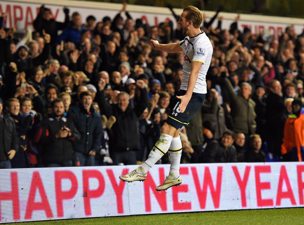Harry Kane celebrates one of his two goals against Chelsea