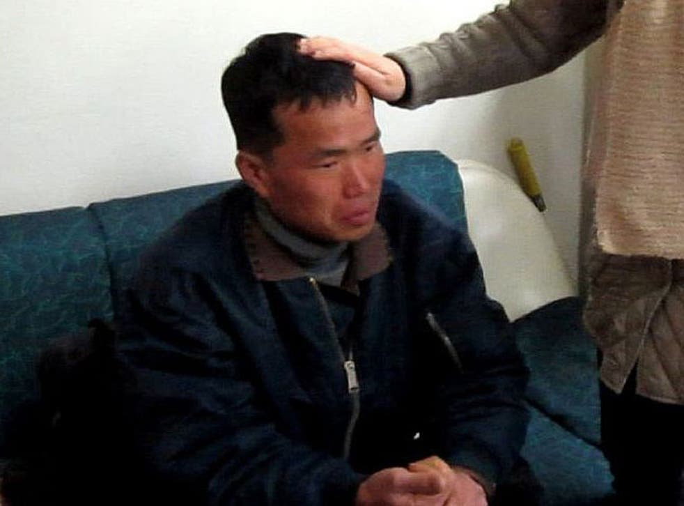 Kim Seong-baek, meets with his mother after he was rescued from a salt farm