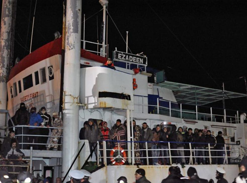 Italian police looks at migrants aboard the cargo ship 'Ezadeen' after the vessel arrived in the southern Italian port of Corigliano, Italy, 03 January