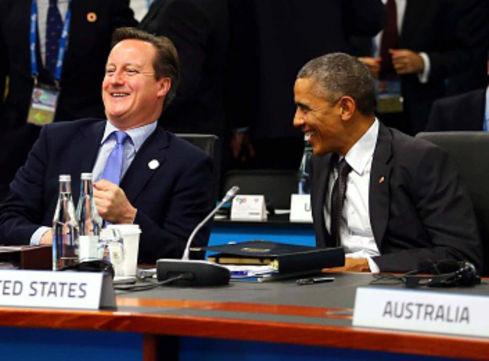 Cameron and Obama chuckling at the G20 Summit in 2014