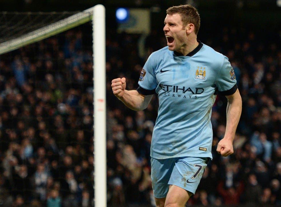 James Milner celebrates scoring his team's first goal