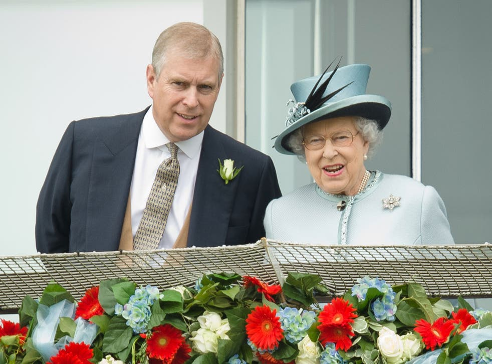 Prince Andrew speaks to the Queen during Derby day at the Epsom Derby Festival, 2013.
