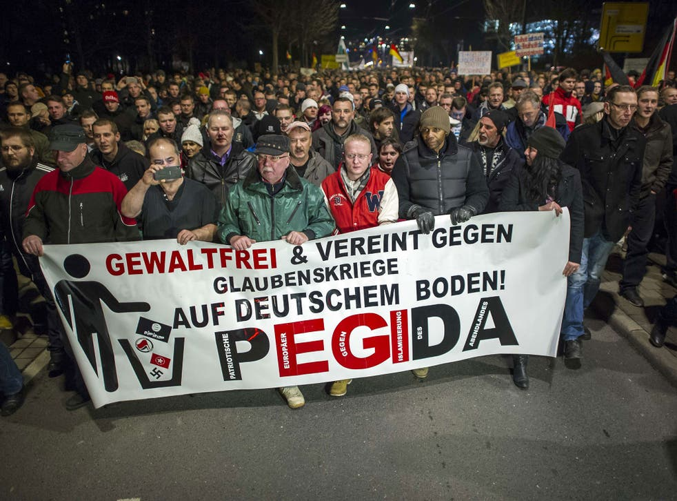 Supporters of the PEGIDA movement, 'Patriotische Europaeer gegen die Islamisierung des Abendlandes,' which translates to 'Patriotic Europeans Against the Islamification of the Occident'