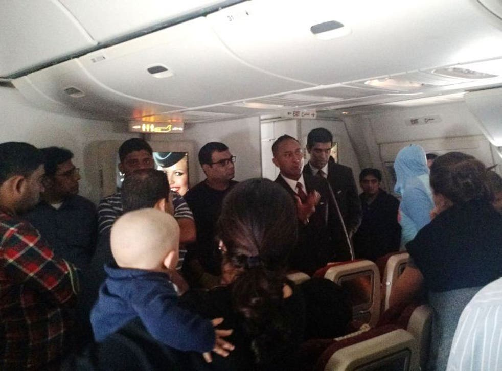 This photo provided by Rithvik Reddy shows passengers aboard  Etihad Airways Flight EY 183 who where stuck on the tarmac for 12 hours on 3 January 2015