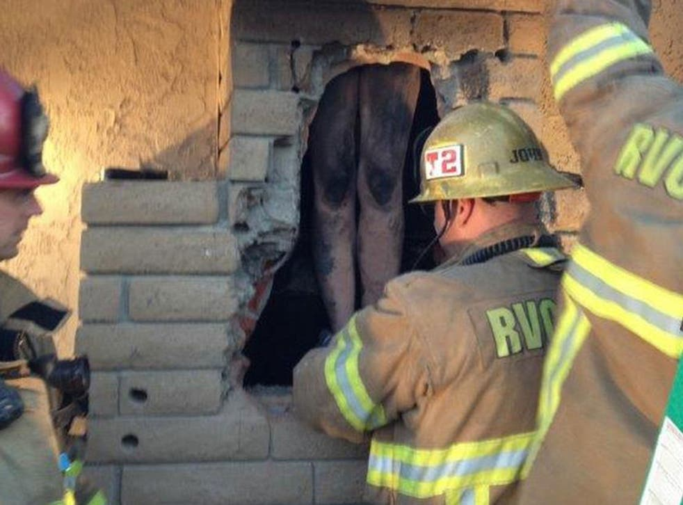 Firefighters rescued a naked woman stuck in a chimney in California.