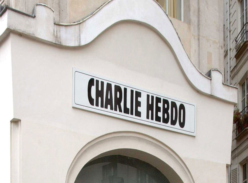 """Police officers and firefighters gather in front of the offices of the French satirical newspaper Charlie Hebdo in Paris, after armed gunmen stormed the offices leaving """"casualties"""", according to the publication's cartoonist, and """"six seriously injured"""" p"""