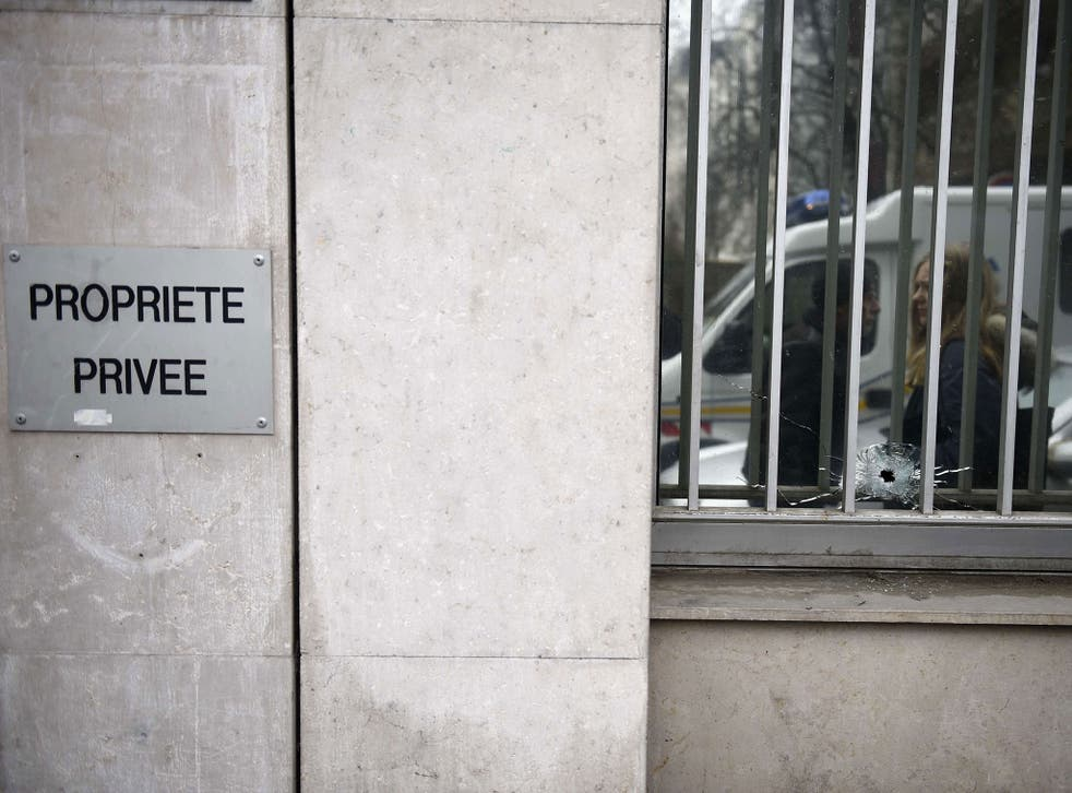 A bullet's impact on the window of the offices of the French satirical newspaper Charlie Hebdo in Paris, after armed gunmen stormed the offices leaving at least 10 people dead