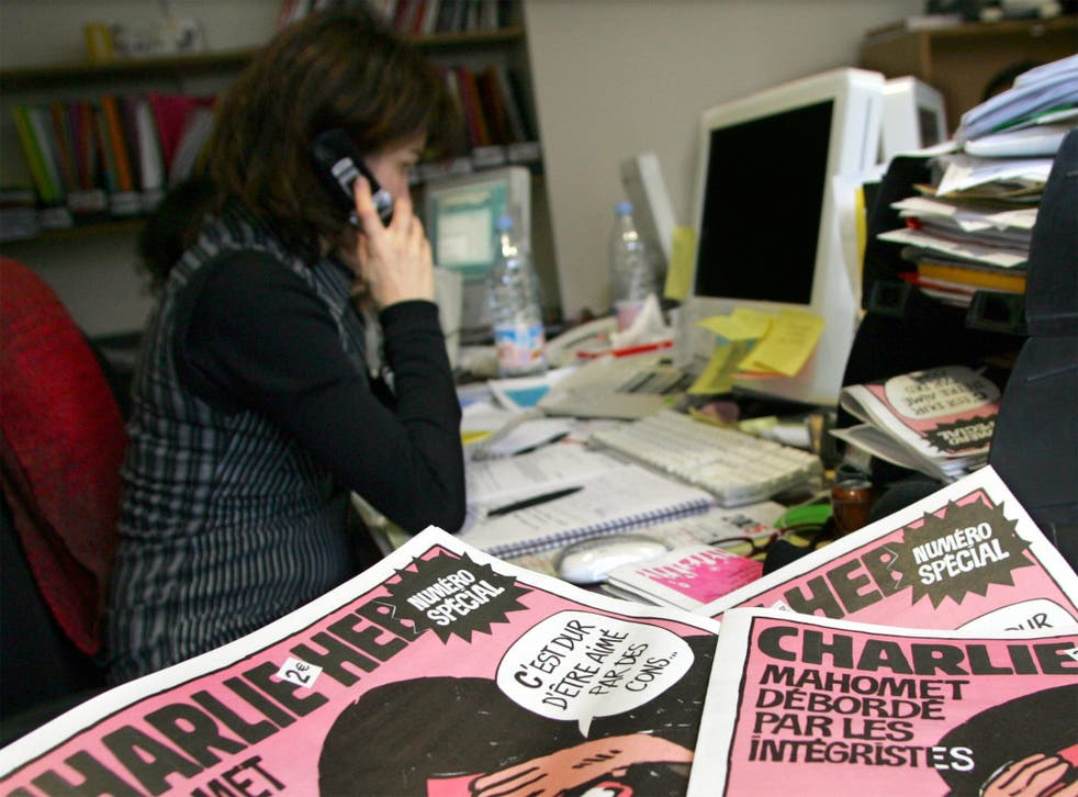 A journalist works in the Paris newsroom of French satirical weekly Charlie Hebdo, in 2006