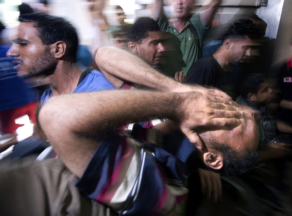 Grief-stricken relatives mourn in Gaza City after four children were killed in July last year by Israeli forces
