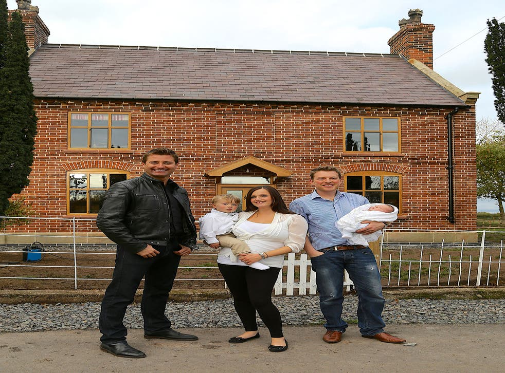 George Clarke (left) with Russell and Nadia outside their cottage in Shropshire