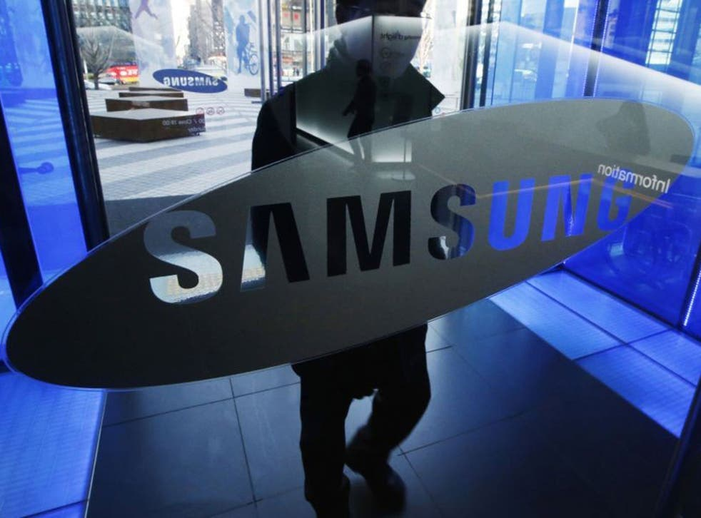 A man walks at the Samsung Electronics' headquarters in Seoul on 7 January, 2015