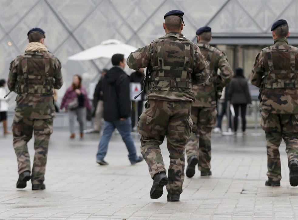 Troops patrol in Paris the day after the terror attack at Charlie hebdo's offices