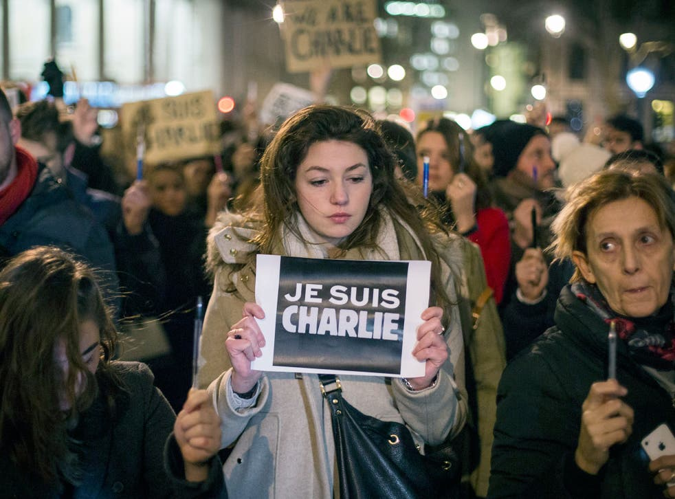 A woman holds a poster reading 'Je suis Charlie' (I am Charlie) during a vigil in Trafalgar Square in London for victims of the terrorist attack at Charlie Hebdo in Paris
