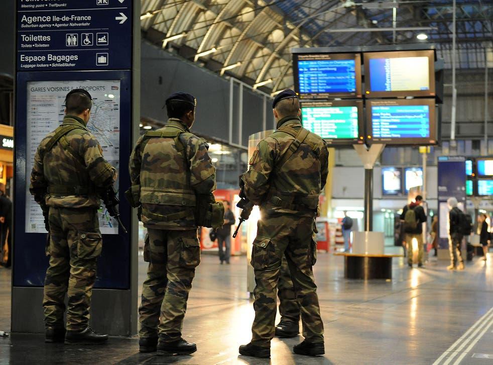 Military personnel patrol the Gare de l'Est railway station in Paris yesterday