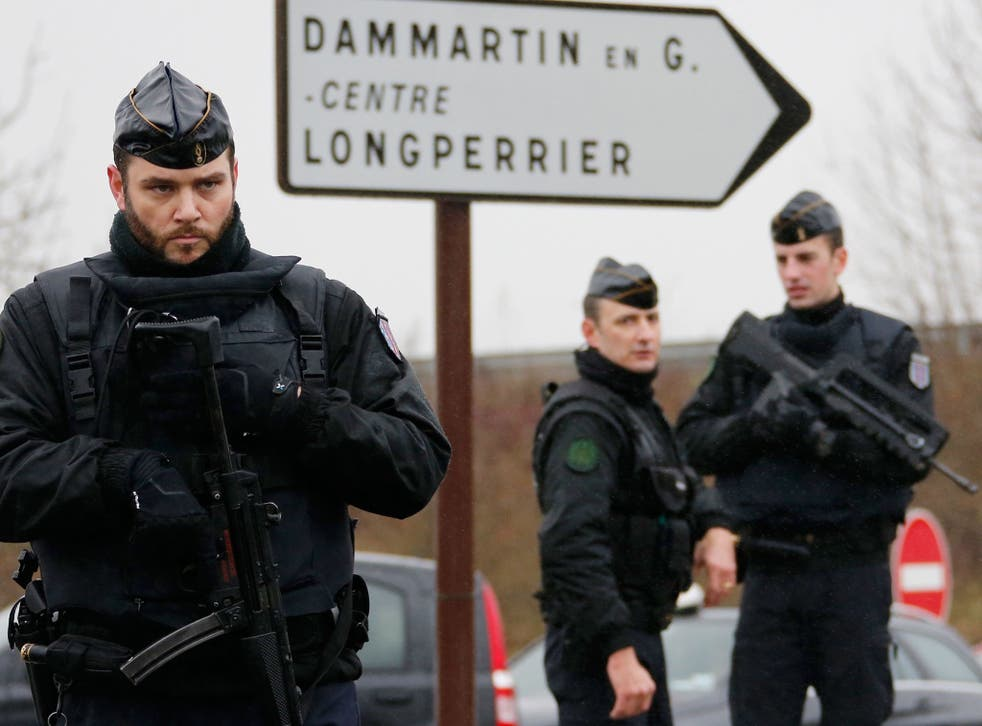 French gendarmes secure the roundabout near the scene of a hostage taking at an industrial zone in Dammartin-en-Goele, northeast of Paris