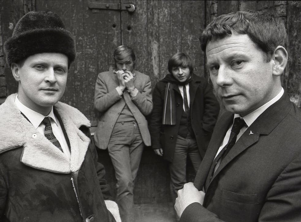 McFall, left, and Bob Wooler outside the Cavern in 1964 – a most unlikely pair to be running a beat club