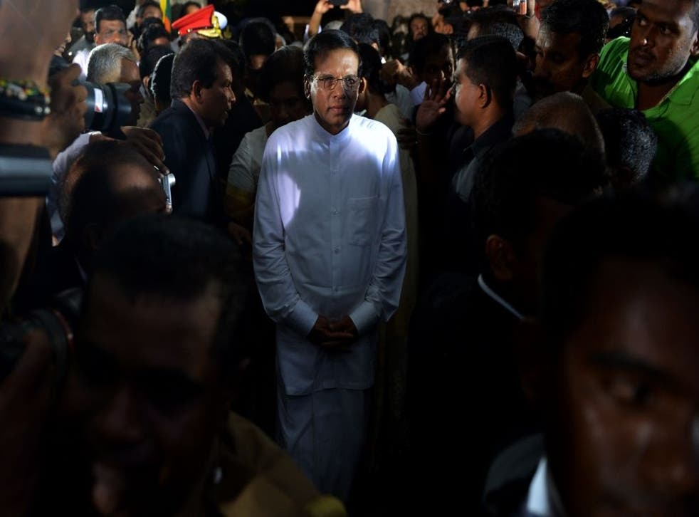 Sri Lanka's newly-elected president Maithripala Sirisena leaves after being sworn in at Independence Square in Colombo