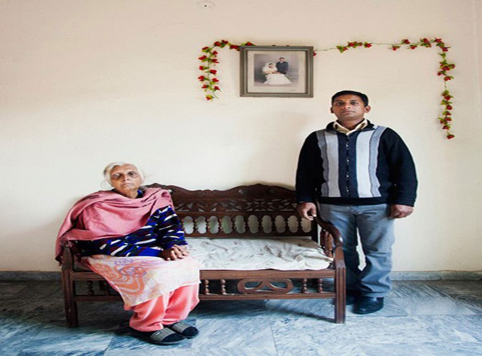 Sylvia Henry Pershaad and her son Arif at home in Lahore. Syvlia's youngest son, Ubeid, has been on death row for nine years