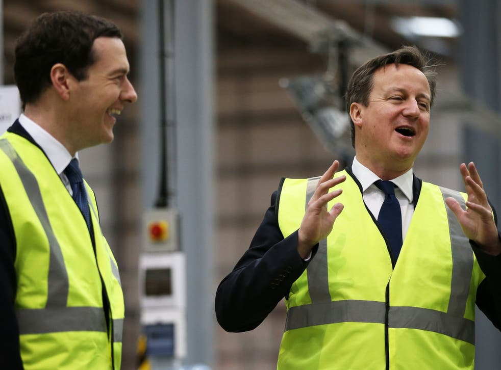 George Osborne (left) and David Cameron visiting Warrington; his office says he is too busy for the debate