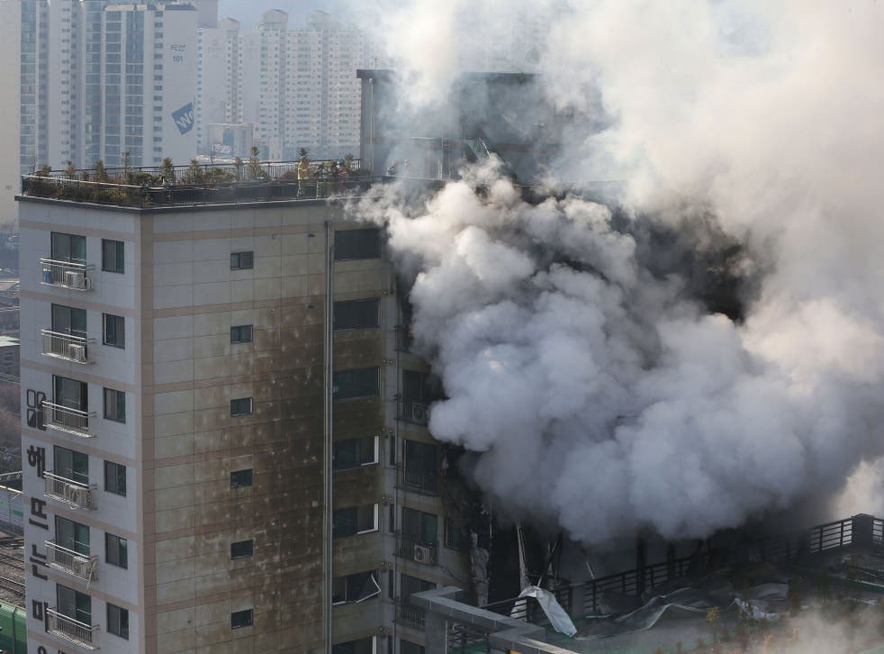 South Korean firefighters (rooftop) battle a blaze at a building which caught fire in Euijeongbu City, north of Seoul, on January 10, 2015.