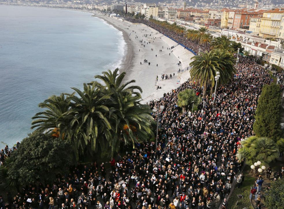 Hundreds of thousands of people march during a rally along the sea front in the Mediterranean city of Nice (AFP)