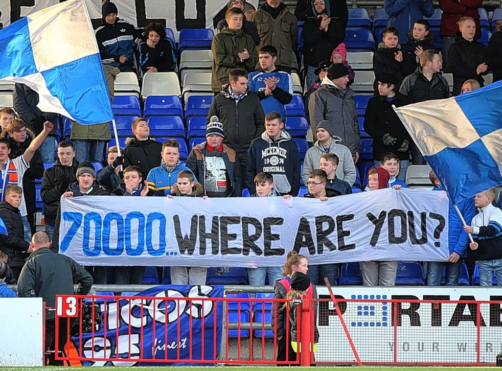 Oldham fans support their team at Boundary Park