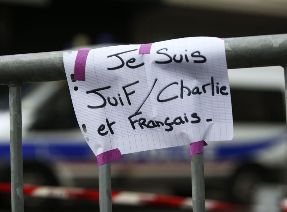 """A message reading """"I am Jewish, Charlie and French"""" taped to a security barrier near the kosher supermarket in Porte de Vincennes (AFP/Getty)"""