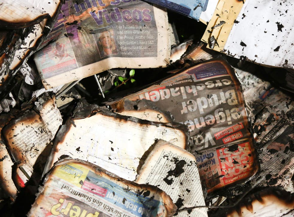 Fire-damaged newspapers at the scene of an arson attack on the headquarters of German daily Hamburger Morgenpost
