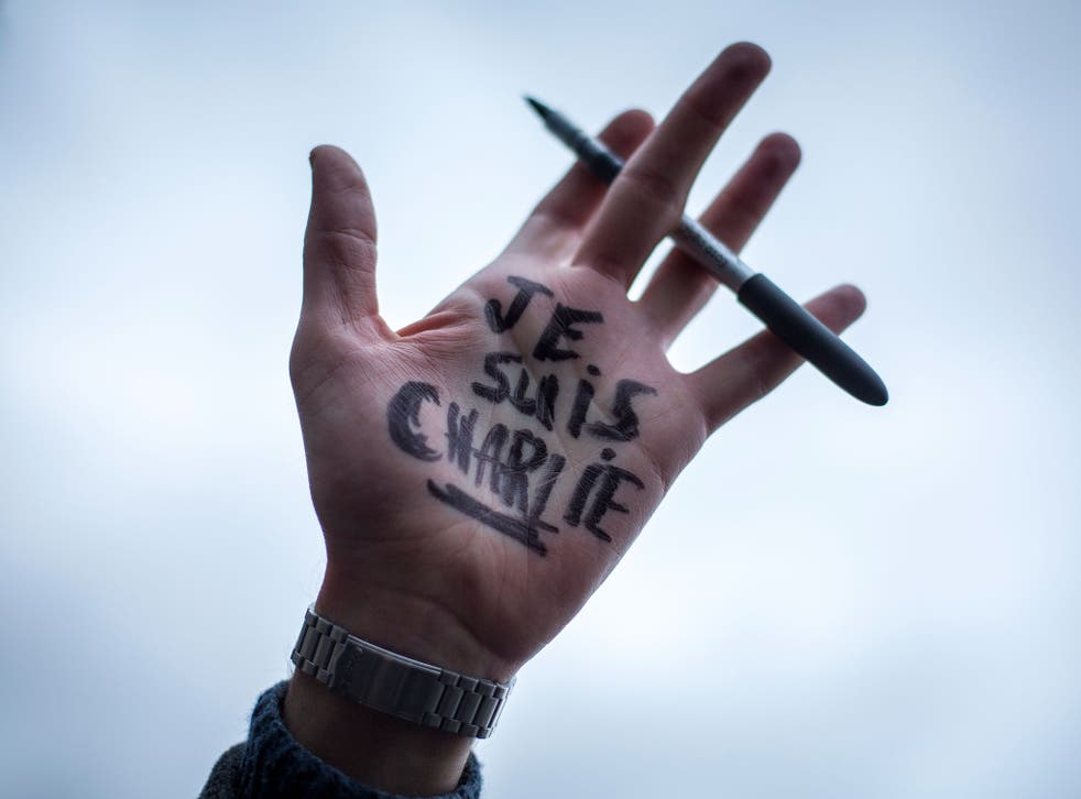 'Je Suis Charlie' written on the hand of a protester at the Paris anti-terrorism demonstration