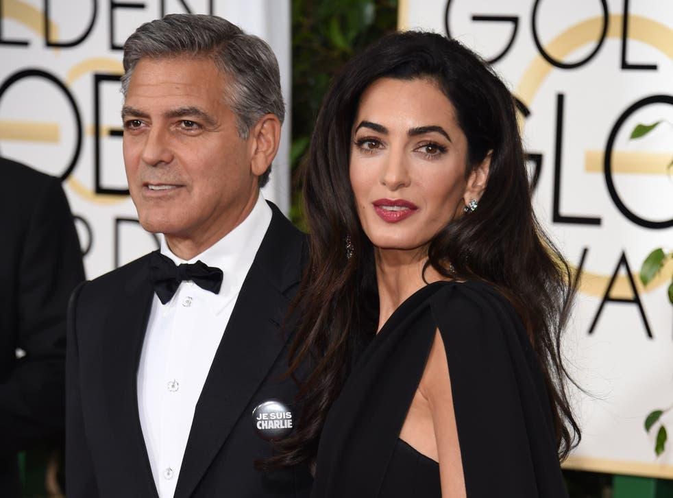 George and Amal Clooney wear 'Je suis Charlie' badges at the Golden Globes 2015