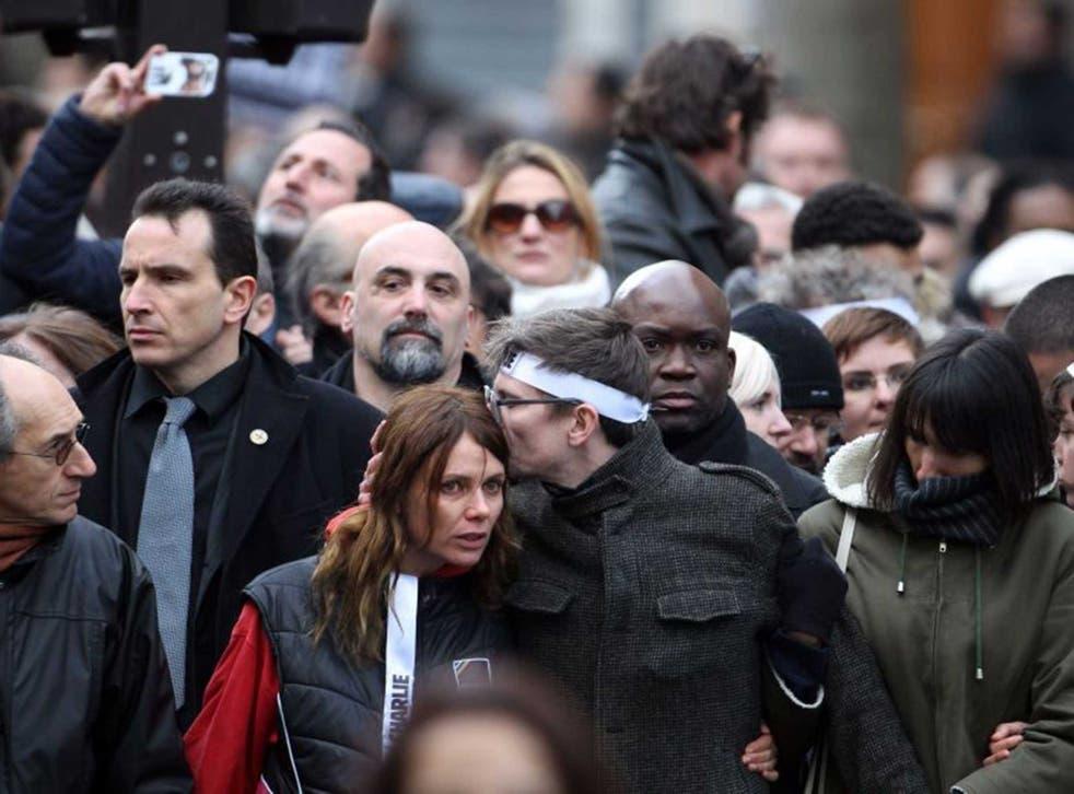 'Charlie Hebdo' staff, including cartoonist Luz (Renald Luzier, wearing headband) at the march through Paris on Sunday