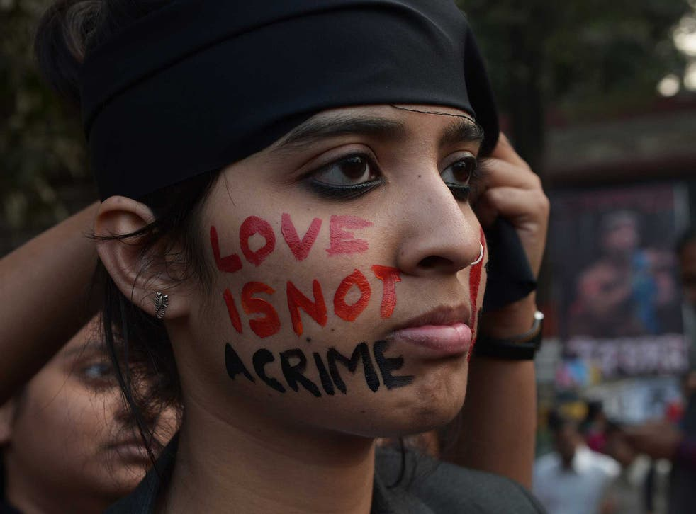 An Indian gay-rights activist takes part in a protest against the Supreme Court ruling reinstating a ban on gay sex in Kolkata on 11 December, 2013