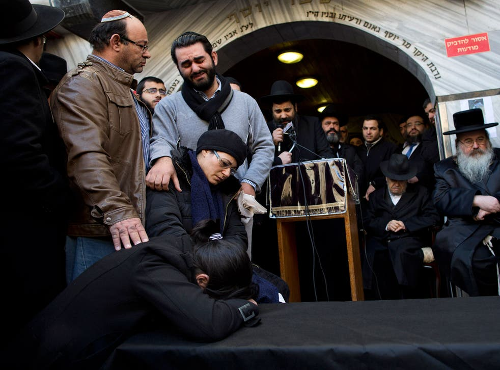 Family and relatives of French Jew Yoav Hattab, a victim of the attack on kosher grocery store in Paris, gather around a symbolic coffin for his funeral procession in the city of Bnei Brak near Tel Aviv, Israel