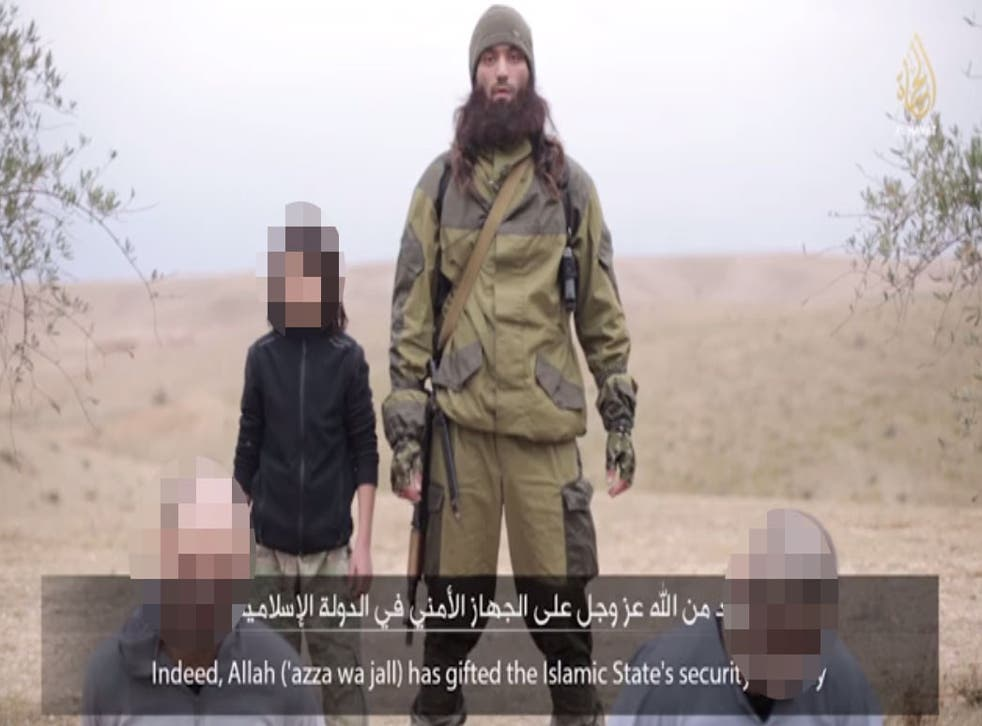 Video posted online by Isis propagandists appears to show the execution of what the group claims are two Russian spies by a young child