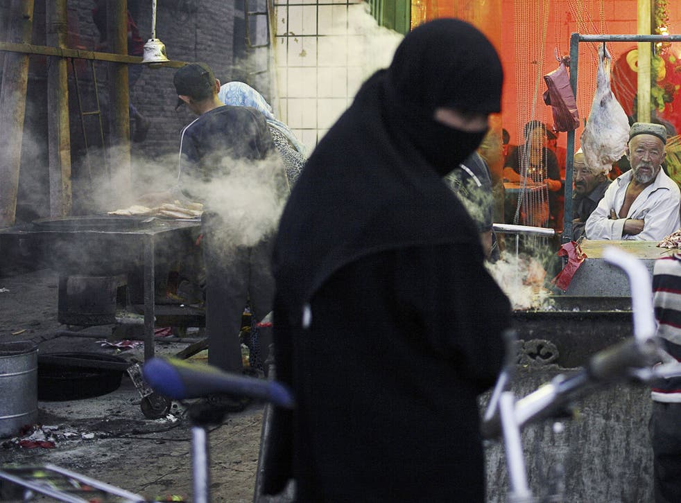 Northwest China's Xinjiang Uighur Autonomous Region approved a regulation banning the wearing of the burqa in the regional capital of Urumqi