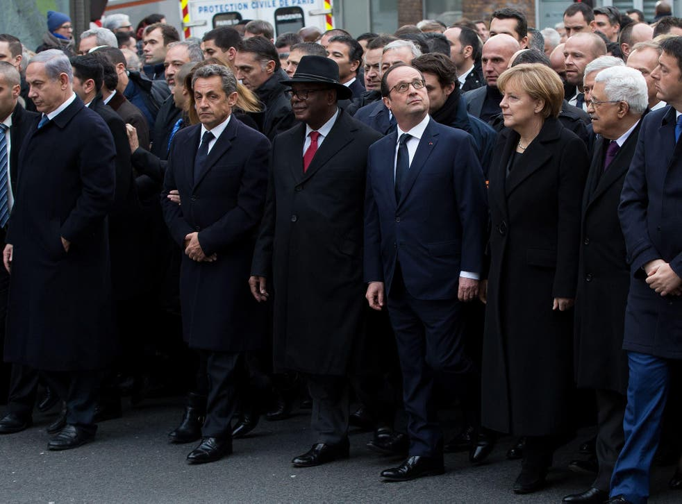 Former President Nicolas Sarkozy appeared to push his way to the front row of the Charlie Hebdo Paris rally