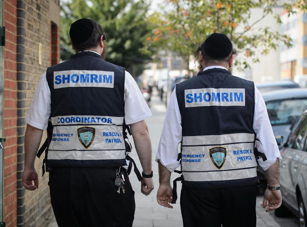 Members of the Jewish 'Shomrim' security patrol team are pictured in north London
